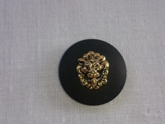 Gold Shield sandblasted on tail metal button