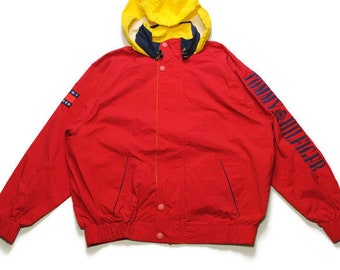 312c3581c vintage TOMMY HILFIGER big logo light Jacket Size L men's red/navy/yellow  hood raincoat windbreaker bright colorway hipster rare 90s 80s