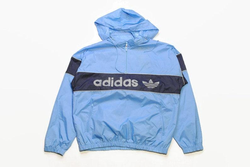 ed55dd242f561 vintage ADIDAS ORIGINALS mens Nylon Hoodie Windbreaker Jacket Reflective  Logo authentic rare retro hood Size M blue hipster rave 90s 80s