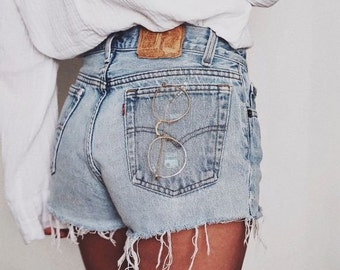 d7e3fdfc40 Vintage Levi's 501 High Waisted Frayed Denim Cut Off Shorts | SIZES 24