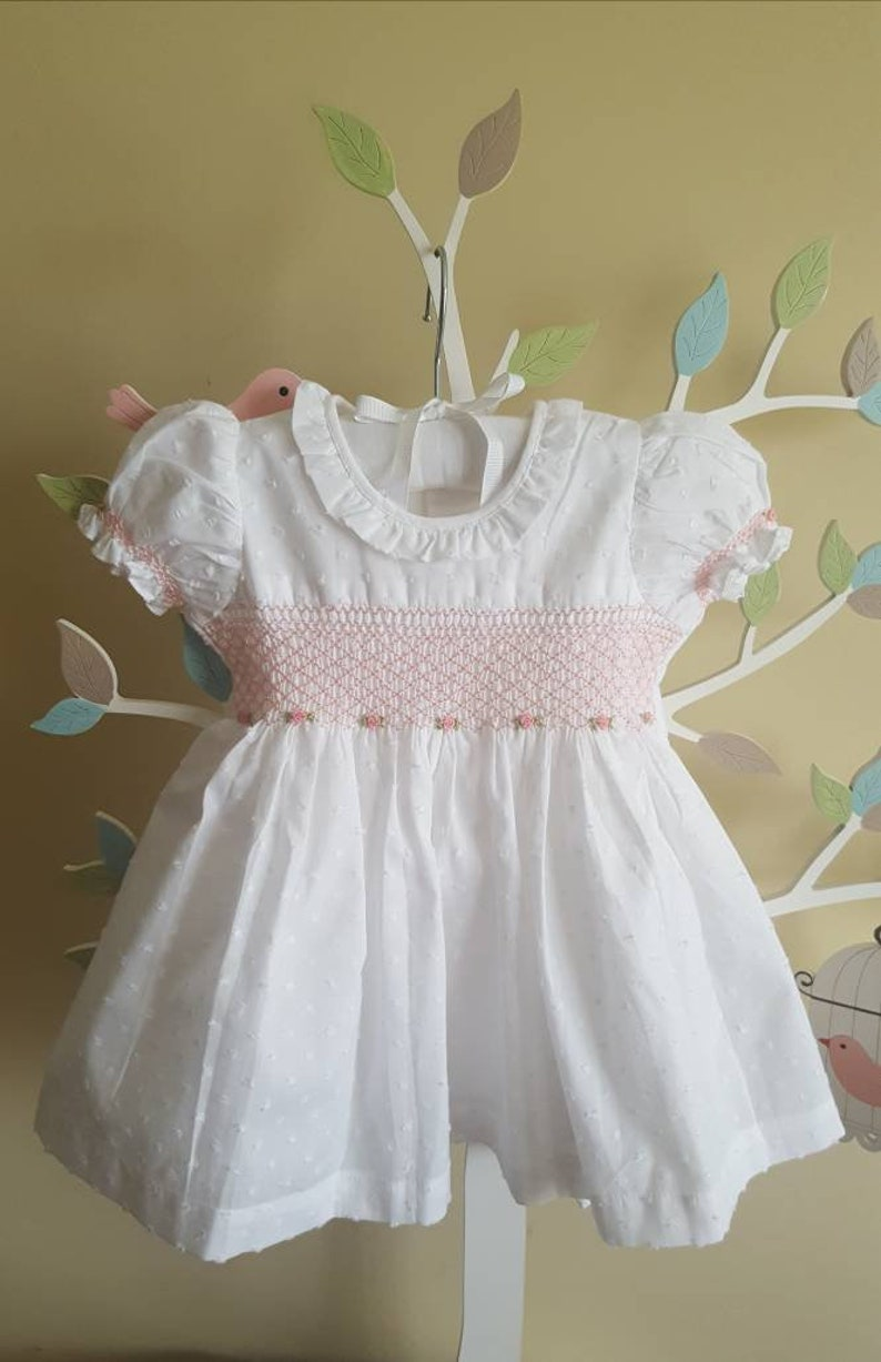 67d60705bf9f Elegant White with Pink hand smocked and hand embroidered baby | Etsy