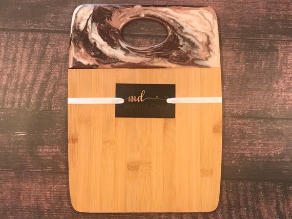 Hand poured resin bamboo cheese/cutting board in blush,ivory, and wine 12x9 with gold trim