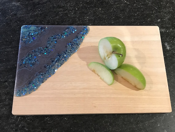 Hand poured in moon and ice blue with glitter accent resin cheese/cutting board 12x7.5 white pine