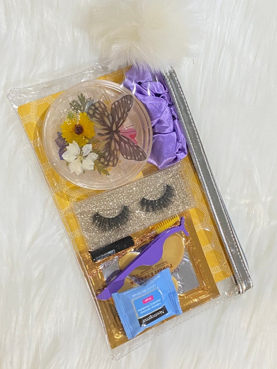 3 pair false lash holder box made of resin with pressed flowers w/ lash kit in matching colors & zippered plastic bag w/ coordinating puff