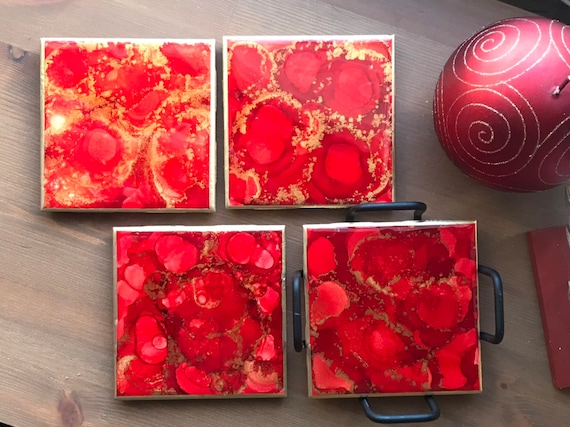 Hand painted 4pc coaster set with metal holder in red, gold, and white ceramic tile with cork backer sealed with resin