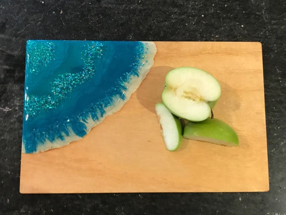Hand poured in teal and aqua with glitter accent resin cheese/cutting board 12x7.5 white pine stained with organic coffee