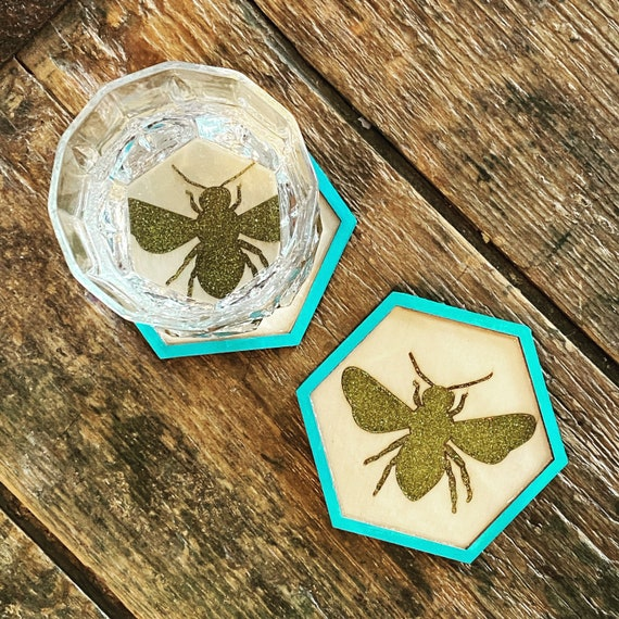 Pair of resin honey glitter bee wooden 3.5 hexagonal coasters with teal and natural balsa accent- cork backed hand painted