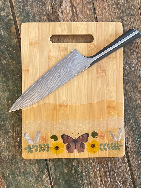 12x8 bamboo butterfly cutting board with quartz crystal points and pressed flowers coated in resin perfect for cheese charcuterie or party
