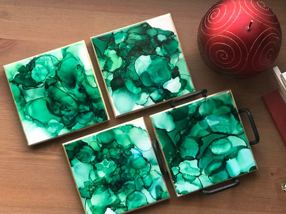 Hand painted 4pc coaster set with metal holder in Hunter green,gold, and white ceramic tile with cork backer sealed with resin