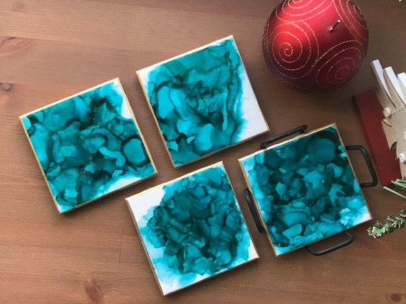 Hand painted 4pc coaster set with metal holder in teal,gold, and white ceramic tile with cork backer sealed with resin