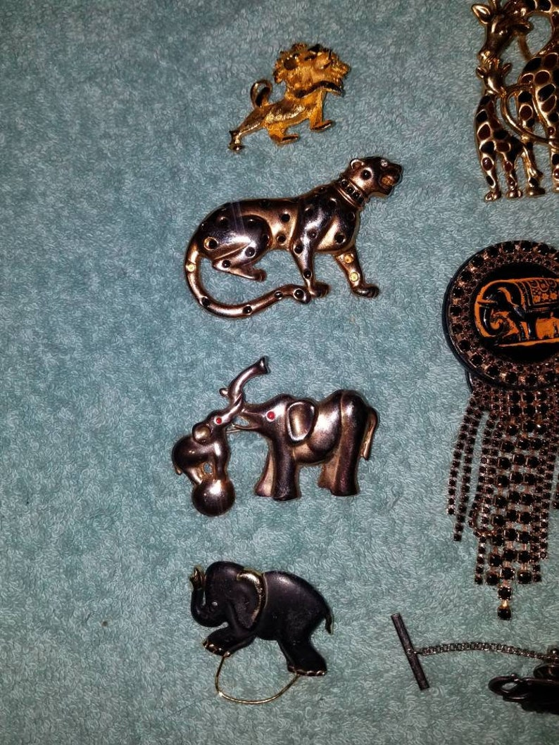 Out of Africa brooch collection lot of 11