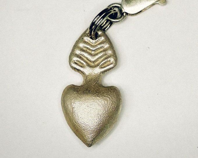 A Milagros sacred heart charm