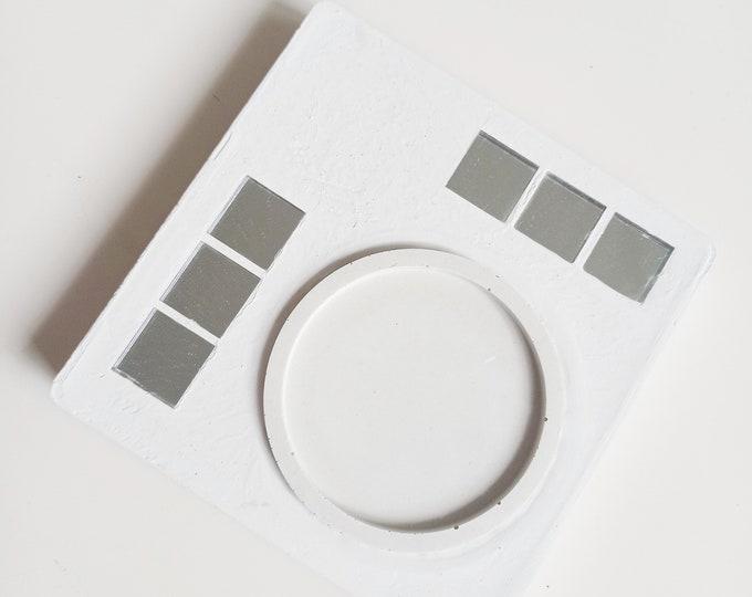 White concrete centerpiece
