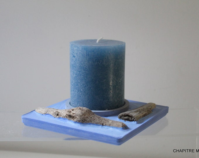 Blue concrete and driftwood table centre