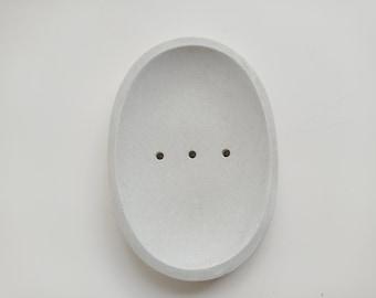 Porte savon ovale en béton blanc