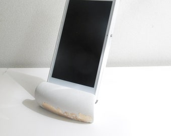 White concrete support for mobile phone
