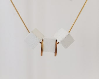 Concrete cube necklace on stainless steel chain
