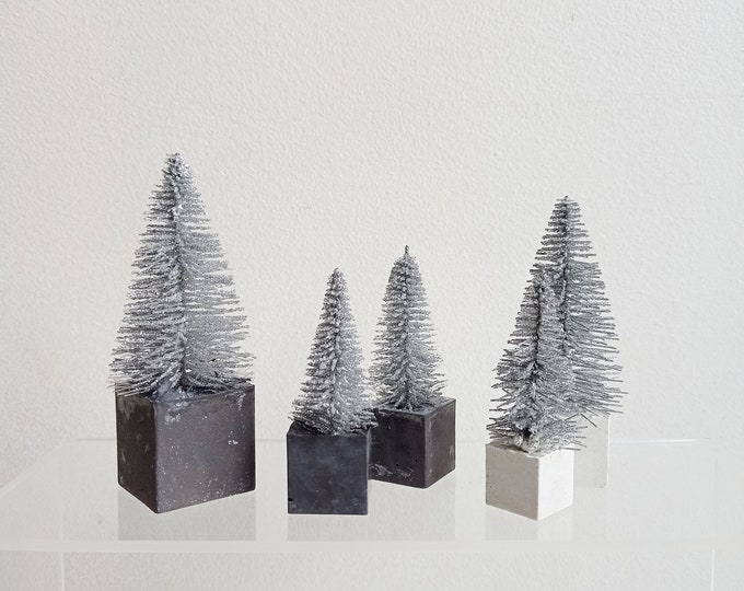 Set of five mini silver firs on black and white concrete base