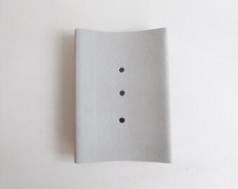 Grey concrete soap door, bathroom accessory