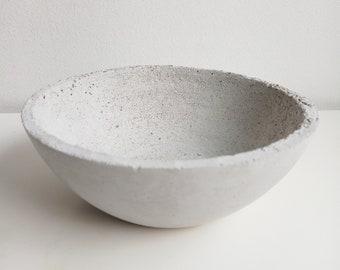 Grey concrete cut, silver shard