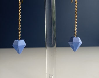 Hanging earrings in blue concrete and stainless steel