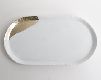 White concrete tray, dotted with gold