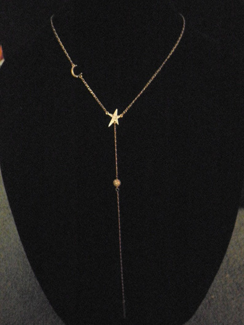 Express star and moon necklace