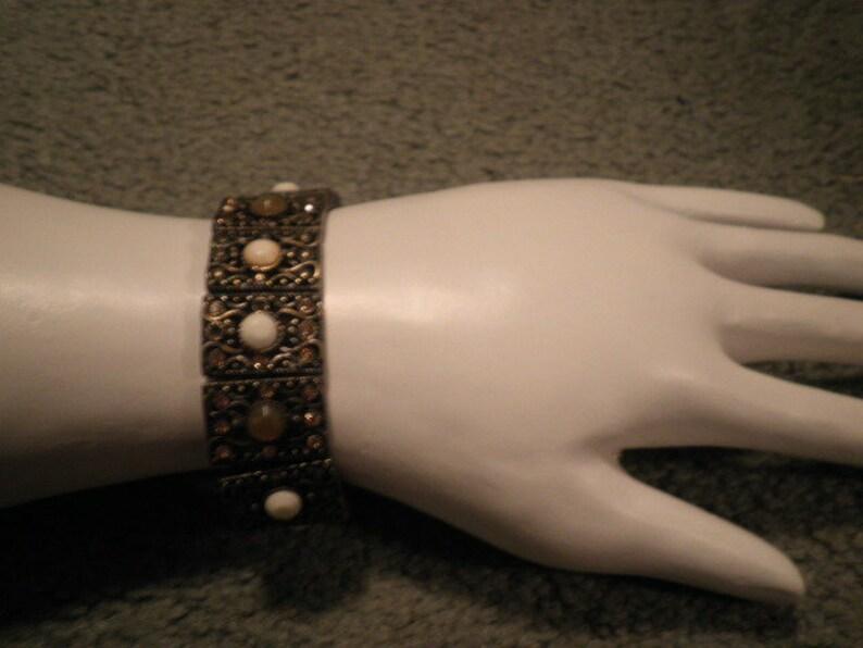 Monet stretch bronze tone bracelet