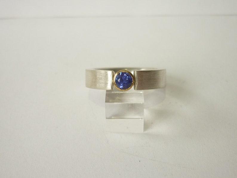 Silver ring tansanite in gold frame image 0