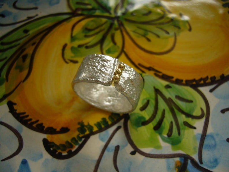 Silver ring with 750 yellow gold balls image 0