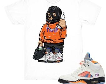 brand new f0f67 da285 Air Jordan 5 International Flight shirt   Trap Bear - Retro 5 Barcelona tee  shirts