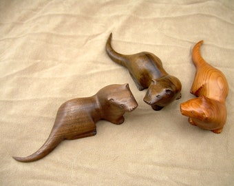 carved wooden otter in walnut or yew