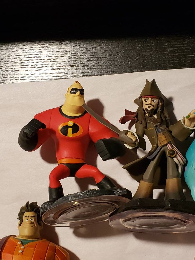 and Sully. Jack Sparrow Mr Incredible Disney Infinity Lot of 4 characters and 4 power discs Wreck It Ralph