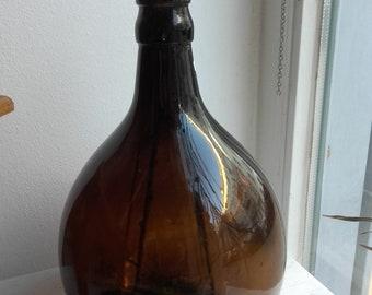 Vase brown amber glass bottle piston