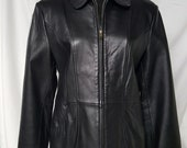 Black leather jacket. Smooth. Soft. Sophisticated styling.