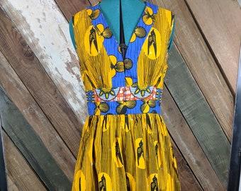 Sleeveless, v-neck, side zip dress. Made with beautiful African print cotton fabrics.