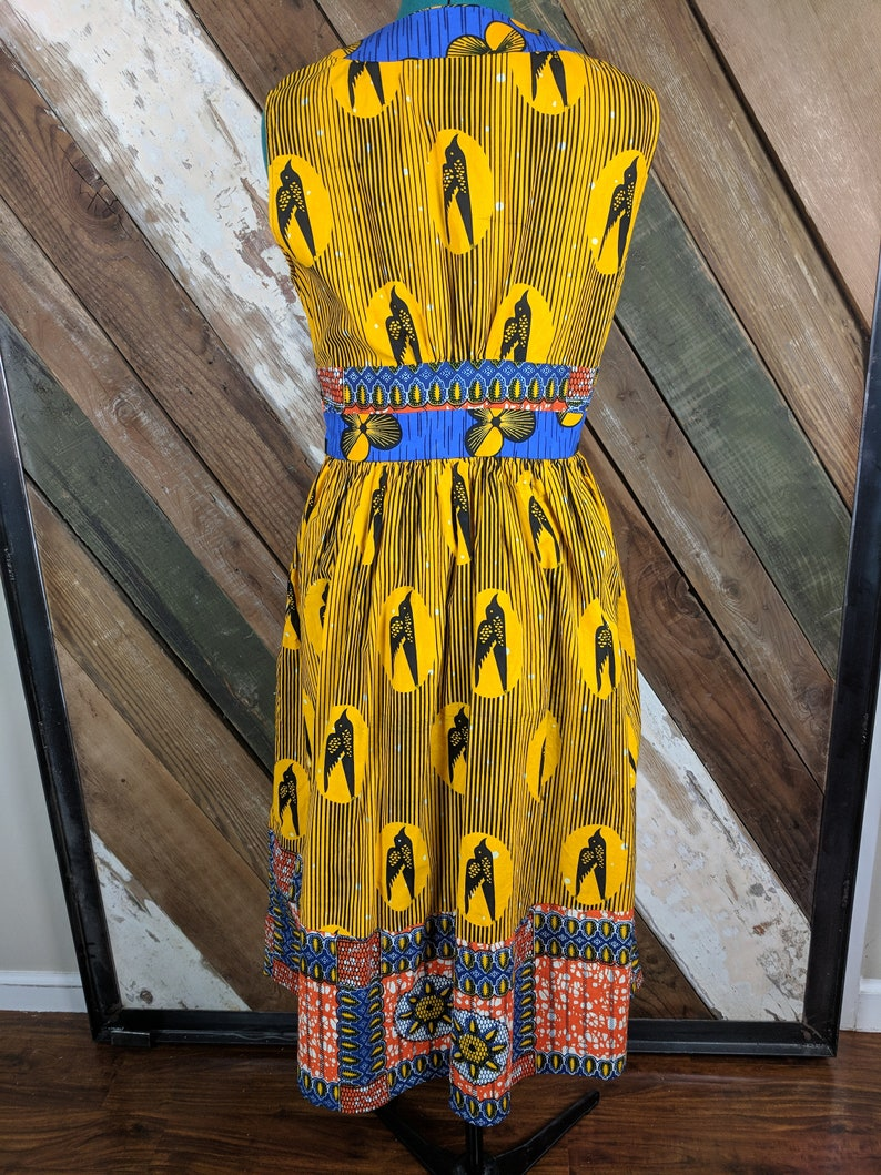 Sleeveless Made with beautiful African print cotton fabrics. side zip dress v-neck