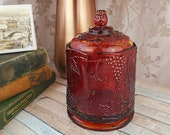 Indiana Glass heavy amberina glass covered octagonal dish, red flashing cylindrical jar, cigar holder, amber glass with grapes and vines