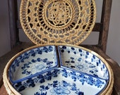 Divided blue floral china dishes in round wicker tray, three sections ceramic china in rattan basket with lid, picnic platter, outdoor tray