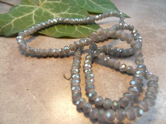 145 Crystal beads 3 x 4 mm SMOKE Rondelle