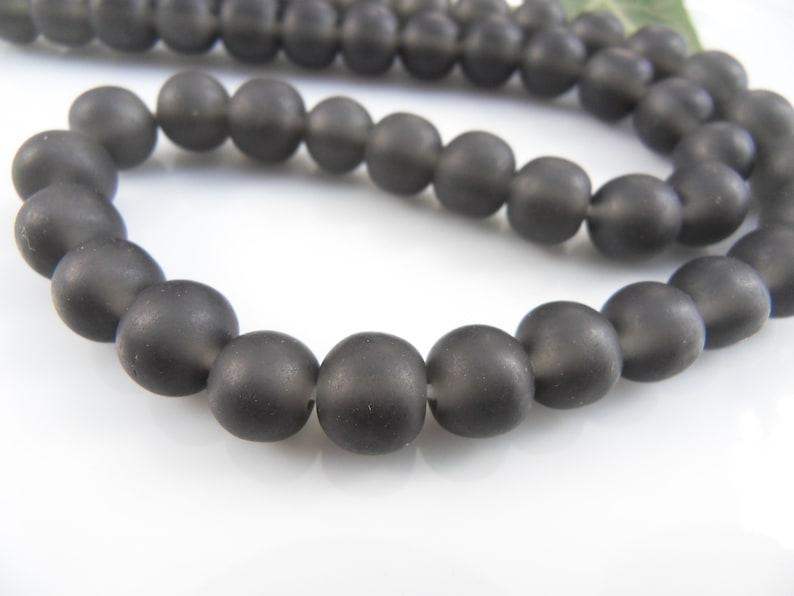 Strand \u00d8 9 mm Grey 46 Round resin beads balls