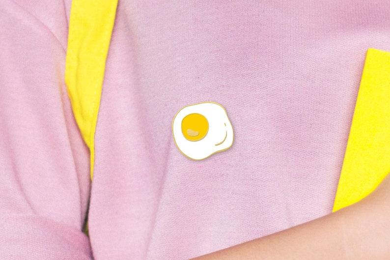 Fried Egg Pin </p>                     </div>   <!--bof Product URL --> <!--eof Product URL --> <!--bof Quantity Discounts table --> <!--eof Quantity Discounts table --> </div>                        </dd> <dt class=