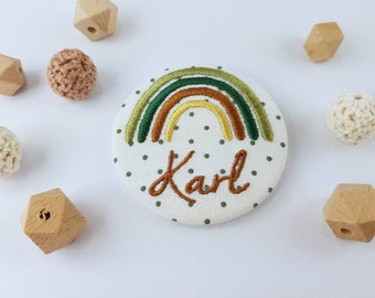 Button / pin with name and rainbow .