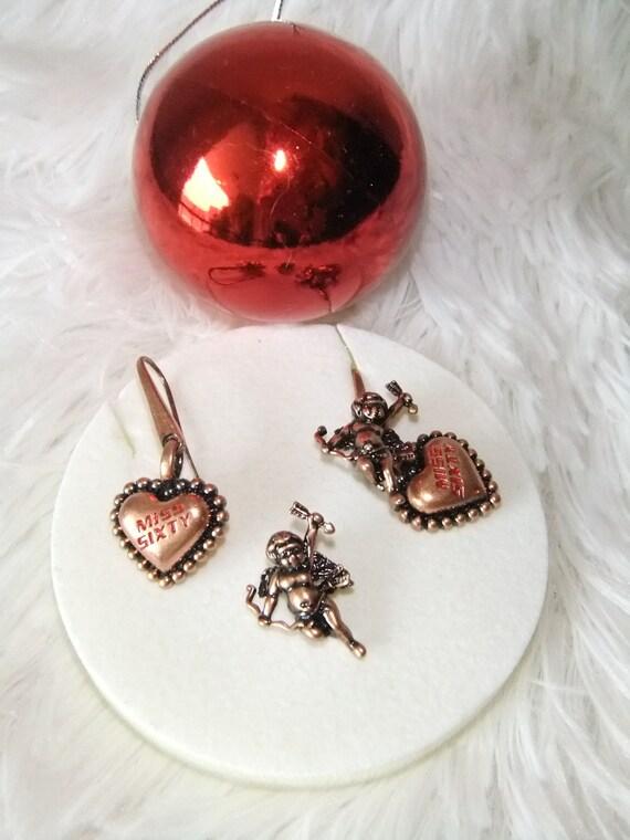 Beautiful earrings angels Miss Sixty