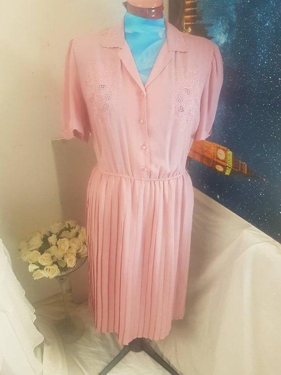 Dusty pink 1980s dress in a 1940s style dress