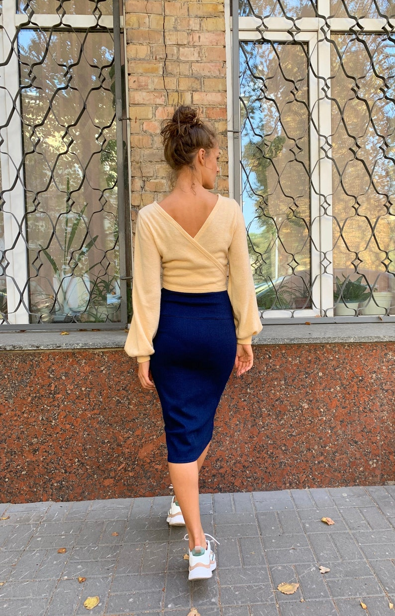 Milk Beige Color Wrap Soft knit Sweater Crop Top with a v-neckline on back and flashlight sleeves