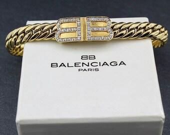 ce8bfeee943f BALENCIAGA – Authentic Vintage Balenciaga Gold Plated Bracelet with  Designer Logo   Original Dustbag and Box