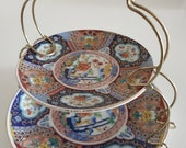 Imari Wear Japan Set of 2 small plates with brass stand