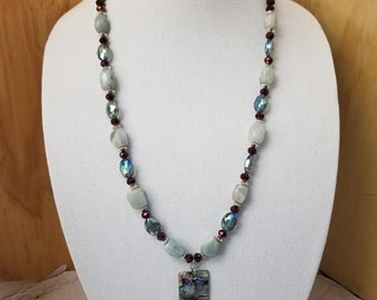 """Abalone Shell Aquamarine Stone 18"""" necklace with glass cut beads and lobster clip closure"""