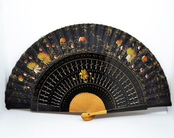 vintage black wood and fabric hand drawn fan